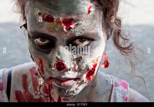 Zombie walk Prague, Czech Republic. 24th May, 2014. Up close headshot of female participating in the zombie walk - Stock Image