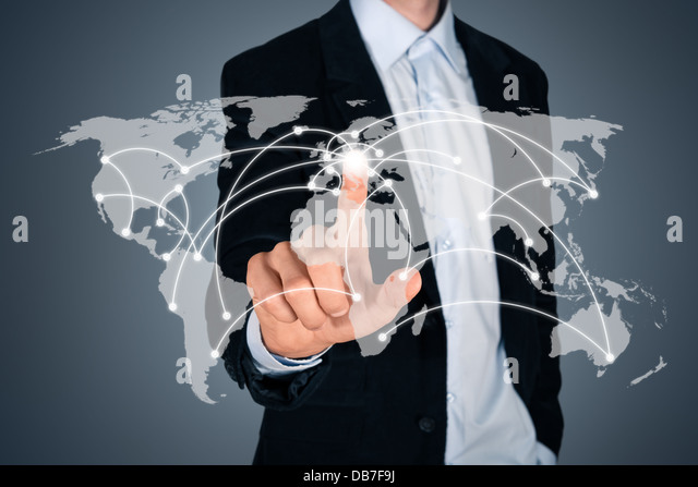 Portrait of handsome businessman touching a world map on the screen showing global connection between different - Stock-Bilder