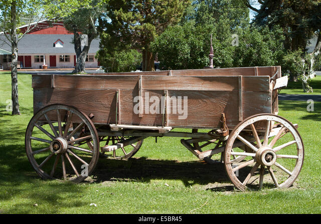 Old Wooden Cart Wheels In Stock Photos & Old Wooden Cart