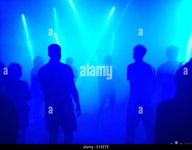 Dancing in blue light - Stock Image