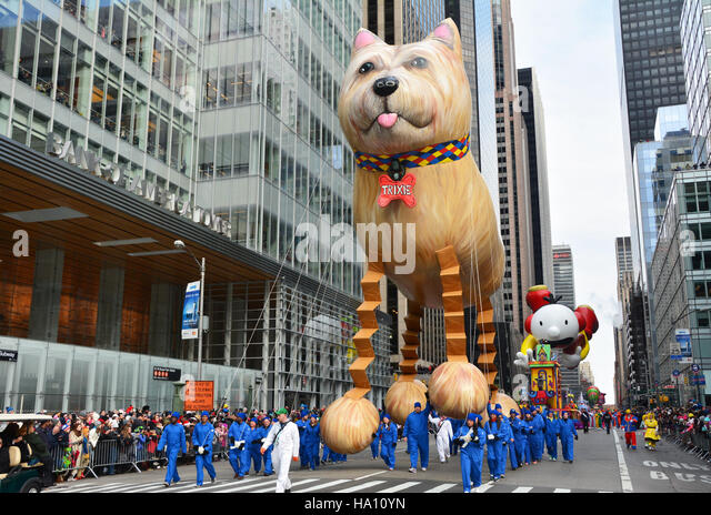 Trixie the Bouncing Dog making his debut this year at the parade. - Stock Image