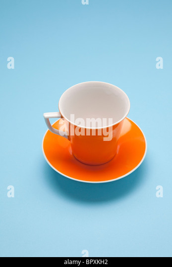 orange coffee cup - Stock Image
