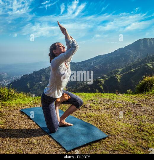 Young woman doing yoga advanced asana - Stock-Bilder