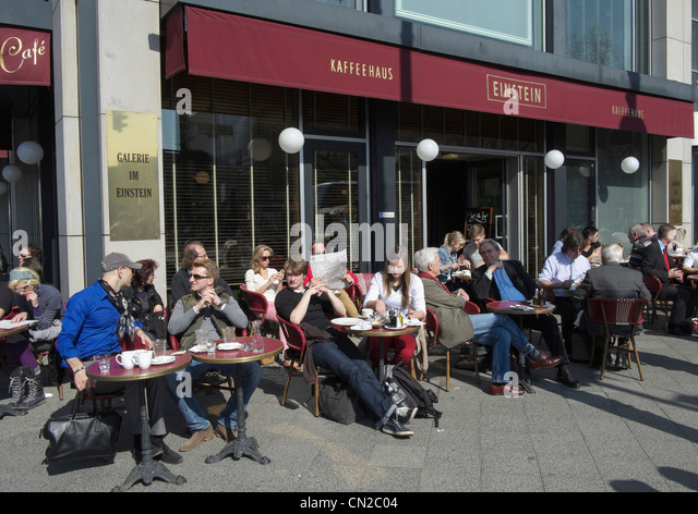 Busy street cafe at famous Cafe Einstein on Unter den Linden in Berlin Germany - Stock Image