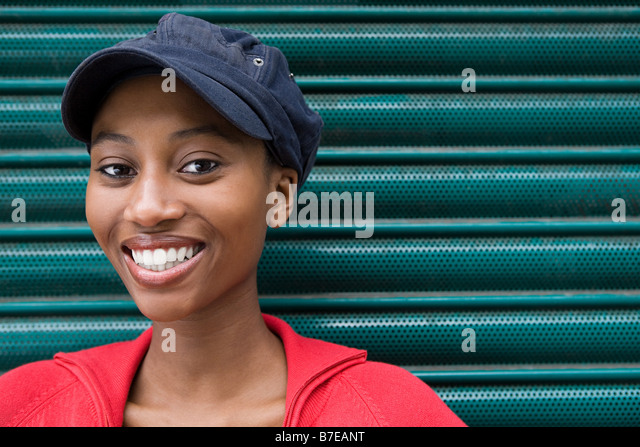 Young woman wearing cap - Stock-Bilder