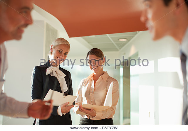 Businessmen talking in office - Stock-Bilder