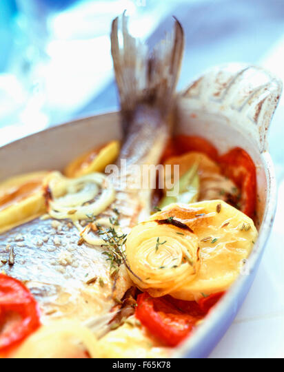 Baked fish with grilled vegetables - Stock Image