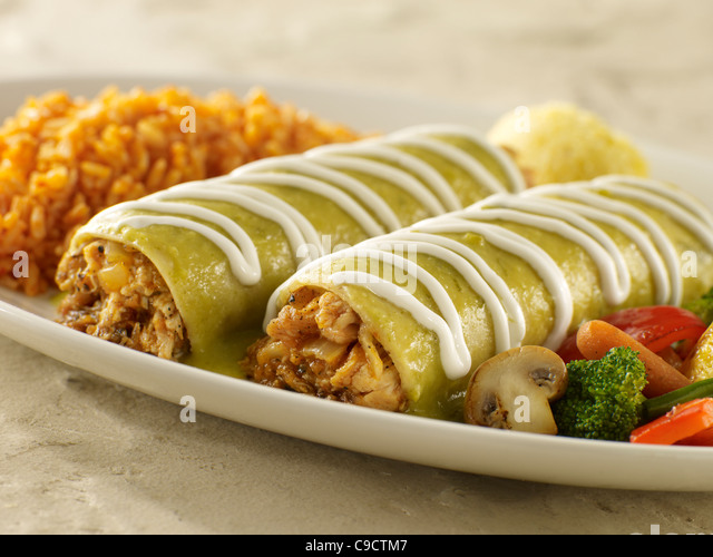 Chicken enchilada suiza with Spanish rice and vegetables - Stock Image
