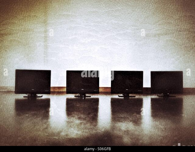 Four monitors. - Stock Image