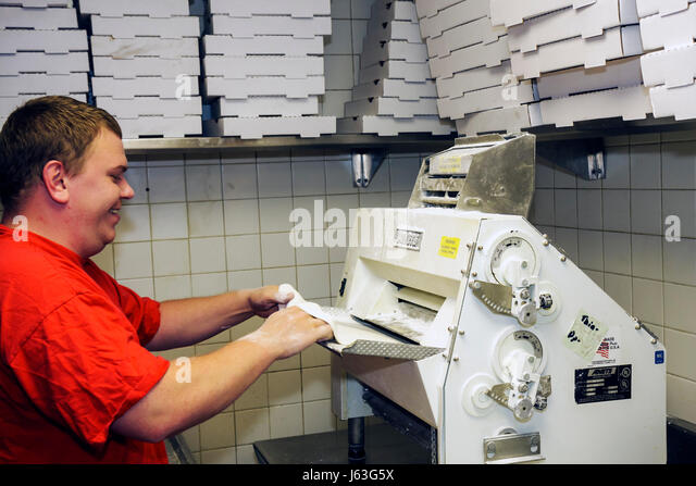 Indiana Portage South Shore Pizza man worker cook pizza dough machine kitchen boxes - Stock Image