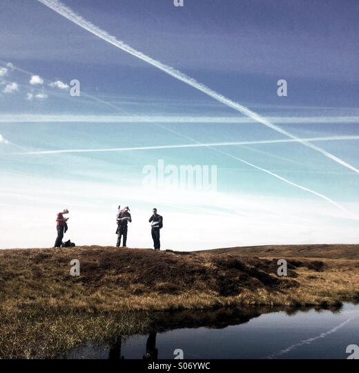 Three hill walkers on moorland in Yorkshire - Stock-Bilder
