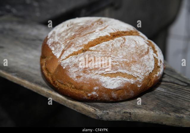 Germany, Upper Bavaria, Egling, Bread in wood stove bakery, close up - Stock-Bilder