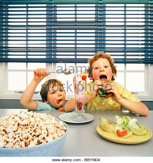 Two boys eating junk food - Stock Image