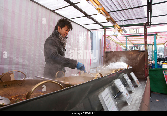 Young Asian man cooking Thai food - Stock Image