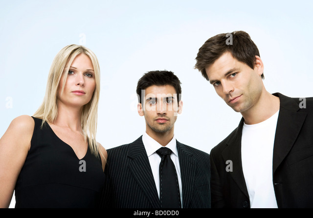 Portrait of three business persons. - Stock Image
