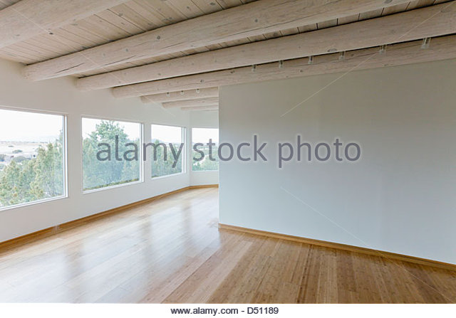 Ceiling beams and hardwood floor in home with scenic views, Santa Fe, New Mexico, USA - Stock Image