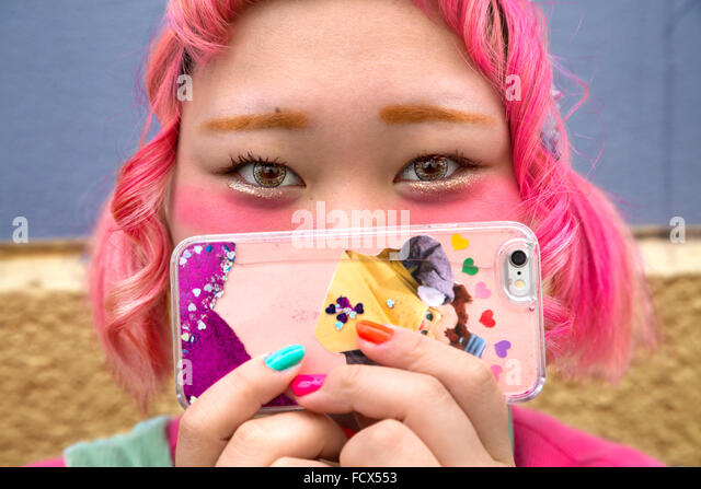 Portrait, Japanese girl fashionable with mobile phone - Stock Image