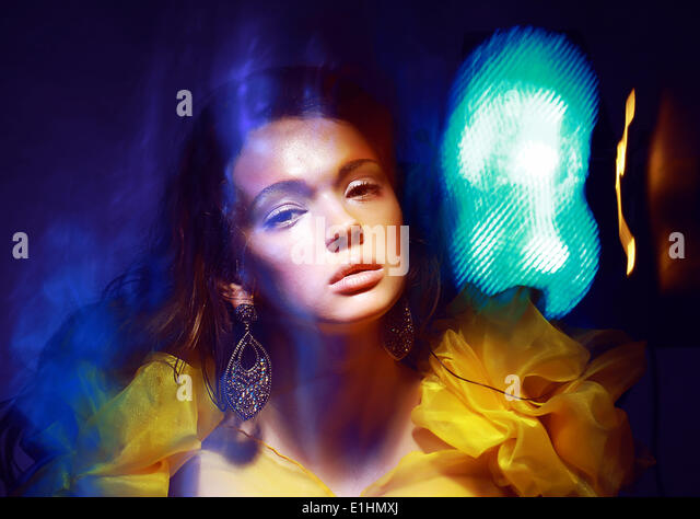 Motion. Stylized Woman in Radiant Abstract Lights. Illusion - Stock Image