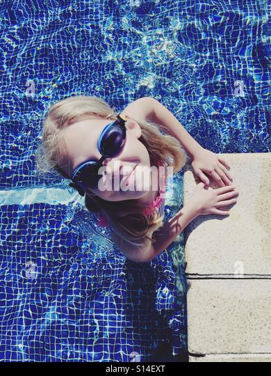 Smiling in the pool - Stock-Bilder