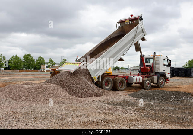 Tipper truck delivering stones at a UK construction site - Stock Image