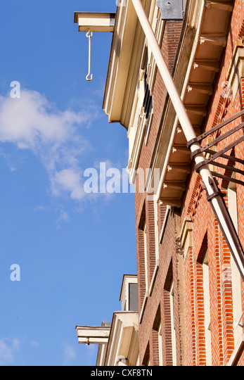 Amsterdam: Hooks at building tops - Amsterdam, Netherlands, Europe - Stock Image