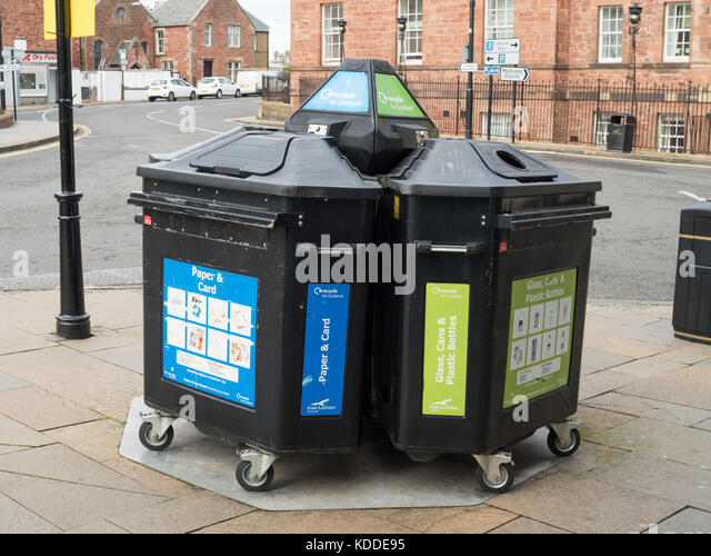 Segregated 3 bay recycling bins on a street corner in the centre of Dunbar, Scotland, UK - Stock Image