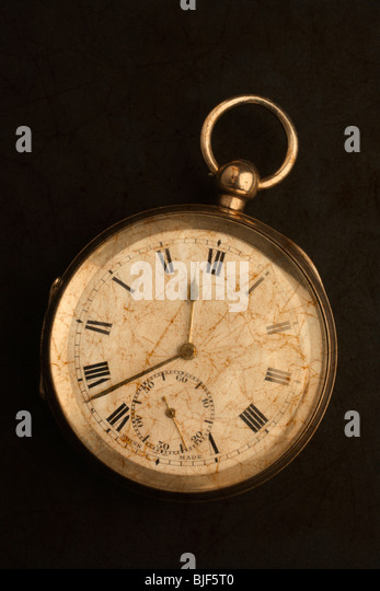 An old gold pocket watch. - Stock Image