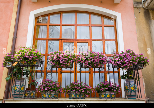 Flat apartment block typical stock photos flat apartment for Best flowers for apartment balcony