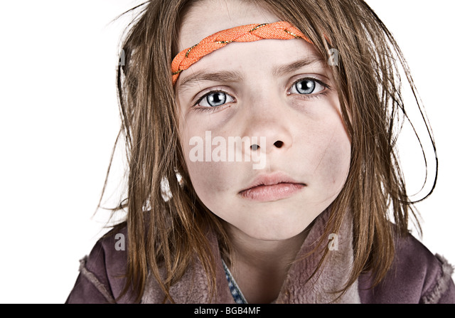 Powerful Shot of a Messy Blonde Child with Headband - Stock Image
