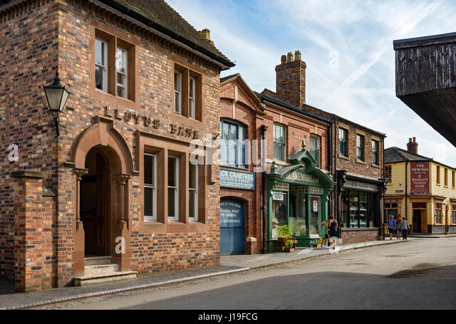 The Bank, Cycle Showroom, Grocer's and Chemist shops at the Blists Hill Victorian Town, near Madeley, Shropshire, - Stock Image