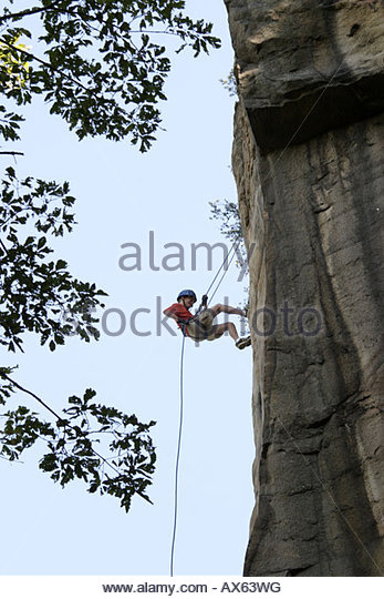 West Virginia Fayetteville New River Gorge National River rock climbing middle school students rapelling cliff - Stock Image