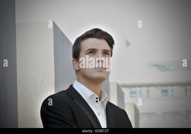 Germany, Berlin, Portrait of well-dressed young man - Stock Image