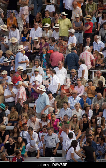 People in the crowd at a bullfight in the Roman Arena, Arles, France - Stock Image