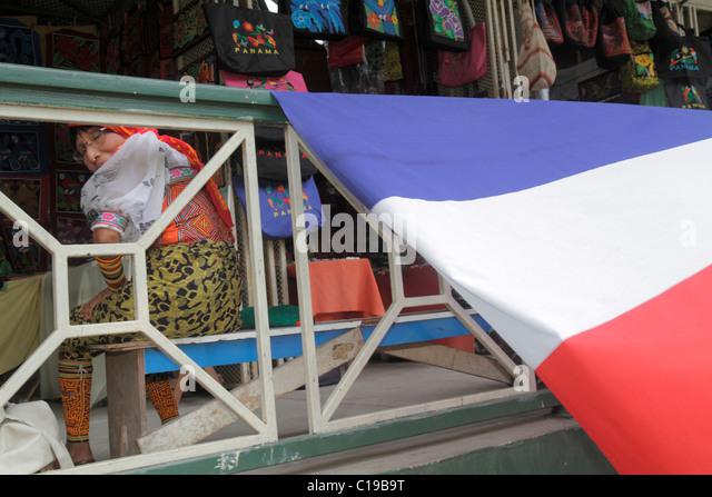 Panama City Panama Balboa Centro de Artesenias shopping handicrafts Kuma Indian mola indigenous woman flag - Stock Image