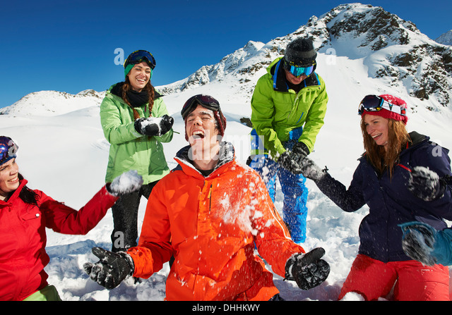 Friends having snowball fight, Kuhtai, Austria - Stock Image
