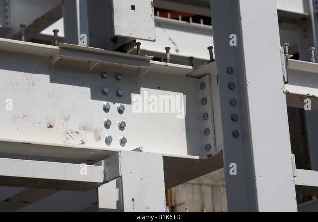 metal I bars bolted together to make the steel frame of a building belfast northern ireland - Stock Image