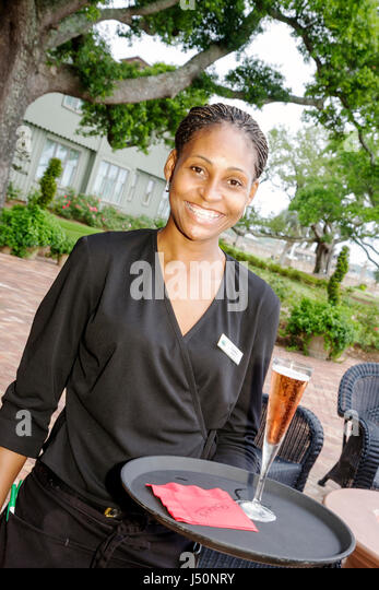 Point Clear Alabama Grand Hotel Marriott Resort hotel lodging Black woman waitress drink service tray - Stock Image