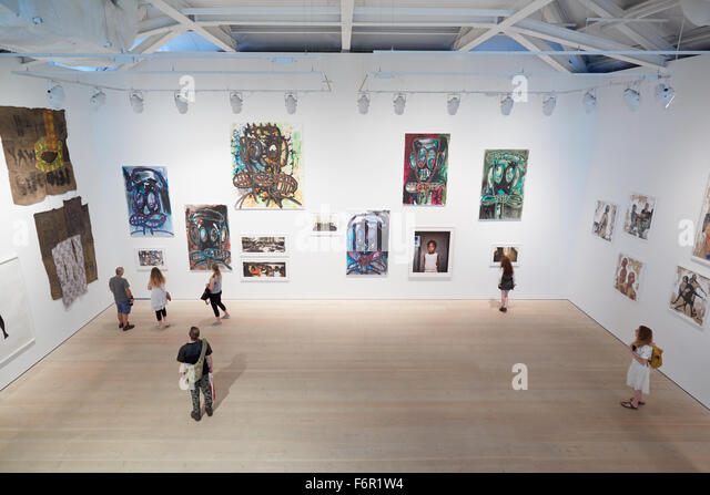 Visitors at art exhibition at the Saatchi Gallery in London - Stock Image