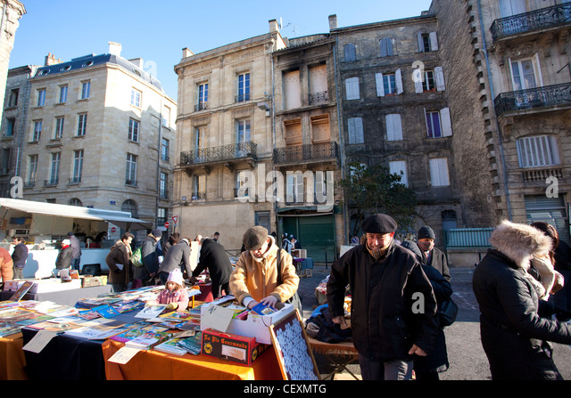 Place Duburg street market, set in the square at St Michel Basilica, Bordeaux, France - Stock Image