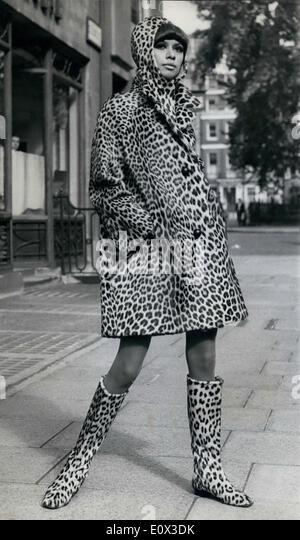 Jan 01, 1965 - A woman wears a leopard print coat and boots in the 1960's. - Stock Image