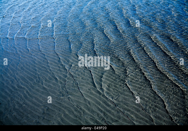 Wave pattern on sandy soil and waves - Stock Image