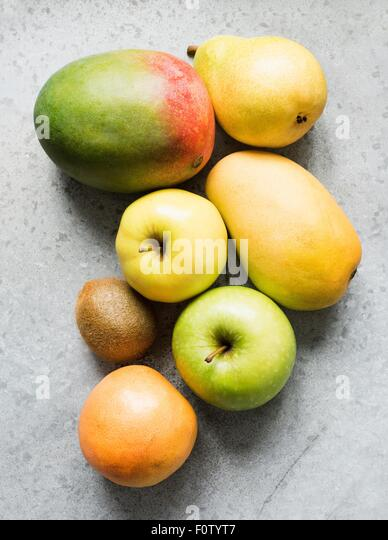 Ripe fruit with apple, mango, kiwi, quince and pear - Stock Image
