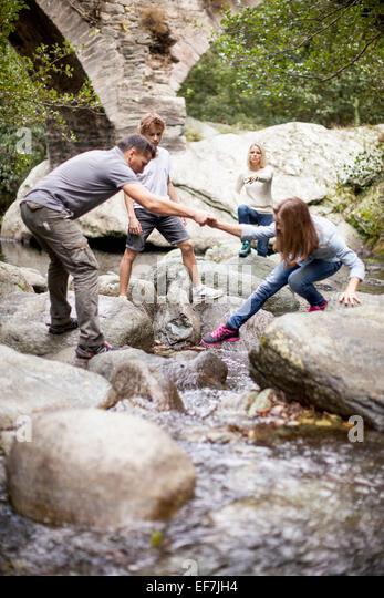 Family in a stream - Stock-Bilder