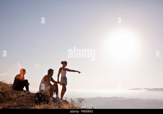 Spain, Alicante, Cocentaina, Tourists in mountains looking at view - Stock Image