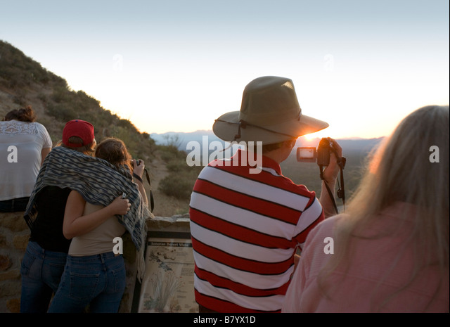 Tourists taking pictures and video at Gates Pass at sunset Gates Pass is in Saguaro national Park in Tucson Arizona - Stock Image