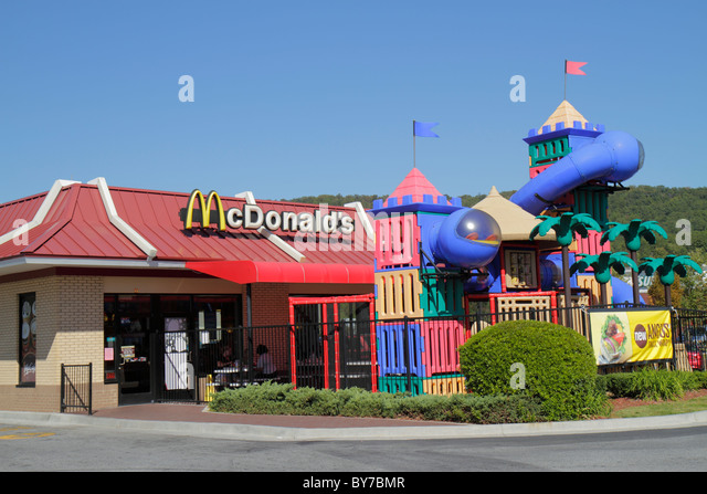 Georgia Cartersville McDonald's hamburger chain global corporation fast food restaurant business franchise sign - Stock Image