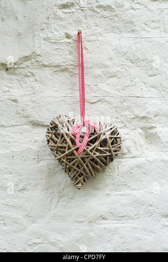 Craft Wooden heart on a front door - Stock Image