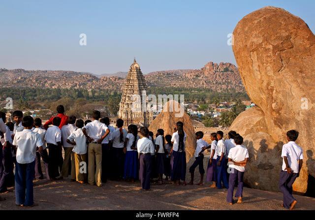 Indian scholars contemplating the Virupaksha temple. Hampi. Karnataka. India - Stock Image