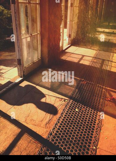 Shadow of a person through a window - Stock Image