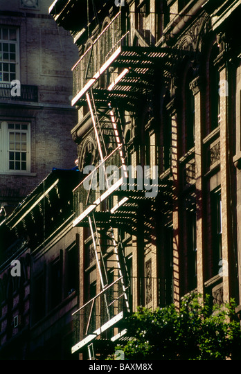 Fire escape stairs in Midtown Manhattan, New York, USA, America - Stock Image